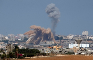 Smoke rises after an Israeli air strike in the northern Gaza Strip